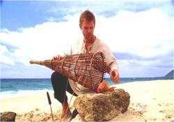 石の上で魚を調理