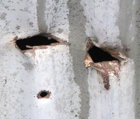 080919傷ついた鉄板