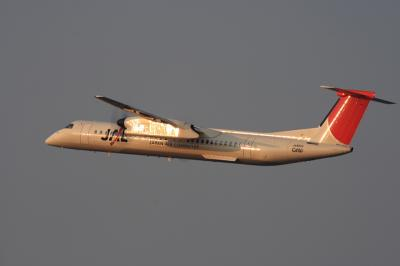 JAC DHC8-Q400 3X2057@RWY14Rエンド脇再開発地区(by EF100-400)