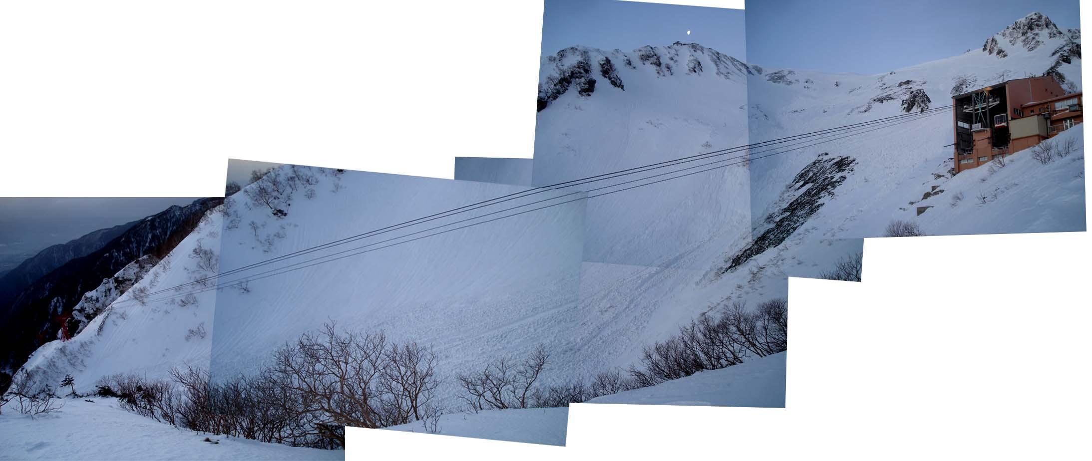 未明のケーブルと谷間の雪崩跡