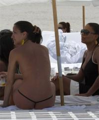 Sanaa Lathan @ beach with a friend whos wearing a micro bikini b05