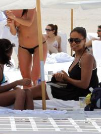 Sanaa Lathan @ beach with a friend whos wearing a micro bikini b09b2
