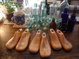 glass bottles and shoe forms